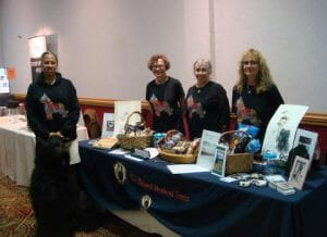 Kath Williams, second from left, helping out at the BMT table at the 2016 BCA Specialty.